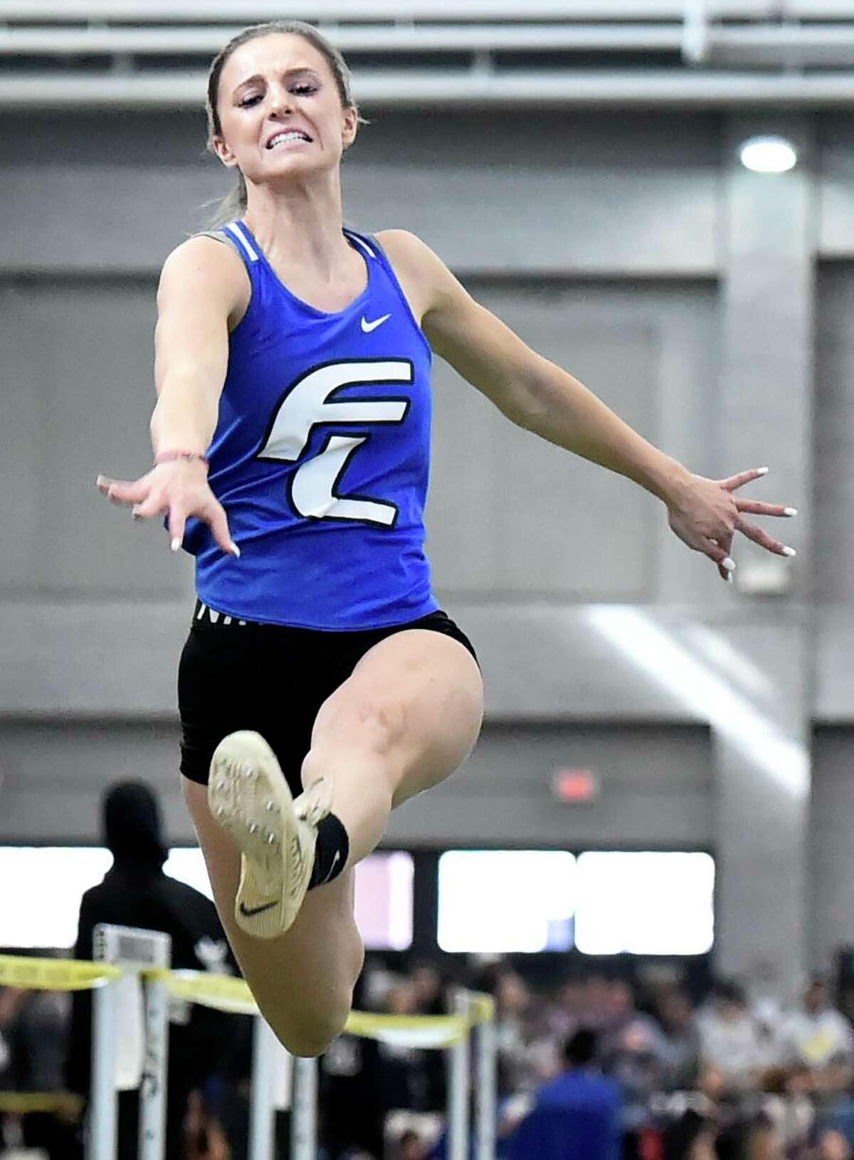 New Haven Connecticut - February 22, 2020: Tess Stapleton of Fairfield Ludlowe H.S. wins first place in the girls long jump during the CIAC State Open Indoor Track Championship Saturday at the Floyd Little Athletic Center in New Haven.