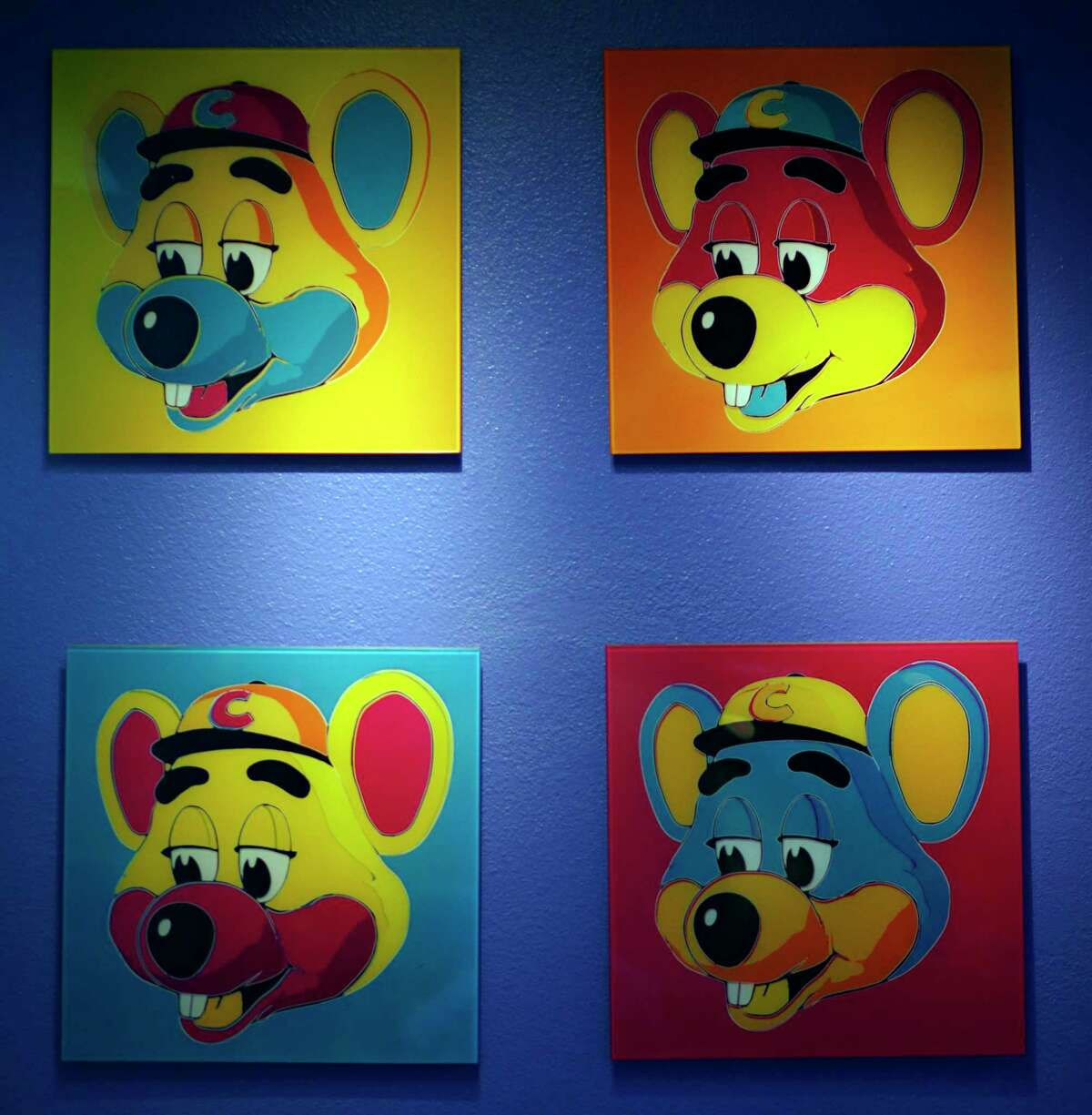 FILE - This Jan. 16, 2014 file photo shows paintings hanging on a wall at Chuck E. Cheese's in Dallas. Chuck E. Cheese pizzeria, that Mecca of fun for children but the bane of many parents, is filing for bankruptcy protection. CEC Entertainment Inc. said Thursday, Jan. 25, 2020, it was filing for voluntary protection under Chapter 11 a€œin order to overcome the financial strain resulting from prolonged, COVID-19 related venue closures.a€ (G.J. McCarthy/The Dallas Morning News via AP)