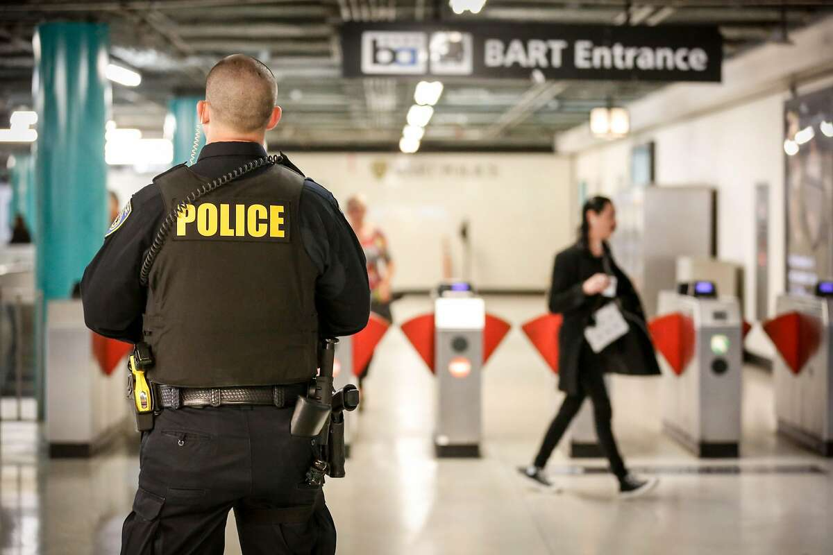 Police officer M. Campbell stands guard at Powell Station BART entrance watching for fare evaders as part of BART's large-scale fare evasion enforcement action on Monday, April 8, 2019 in San Francisco, Calif.