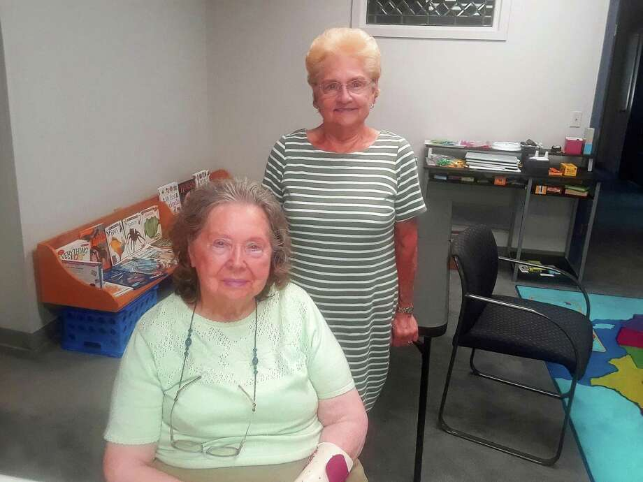 June Zeiner, seated, and Connie Hall, are two of the few remaining members of the Torrington Woman's Club. The group recently decided to disband. Photo: Emily M. Olson / Hearst Connecticut Media