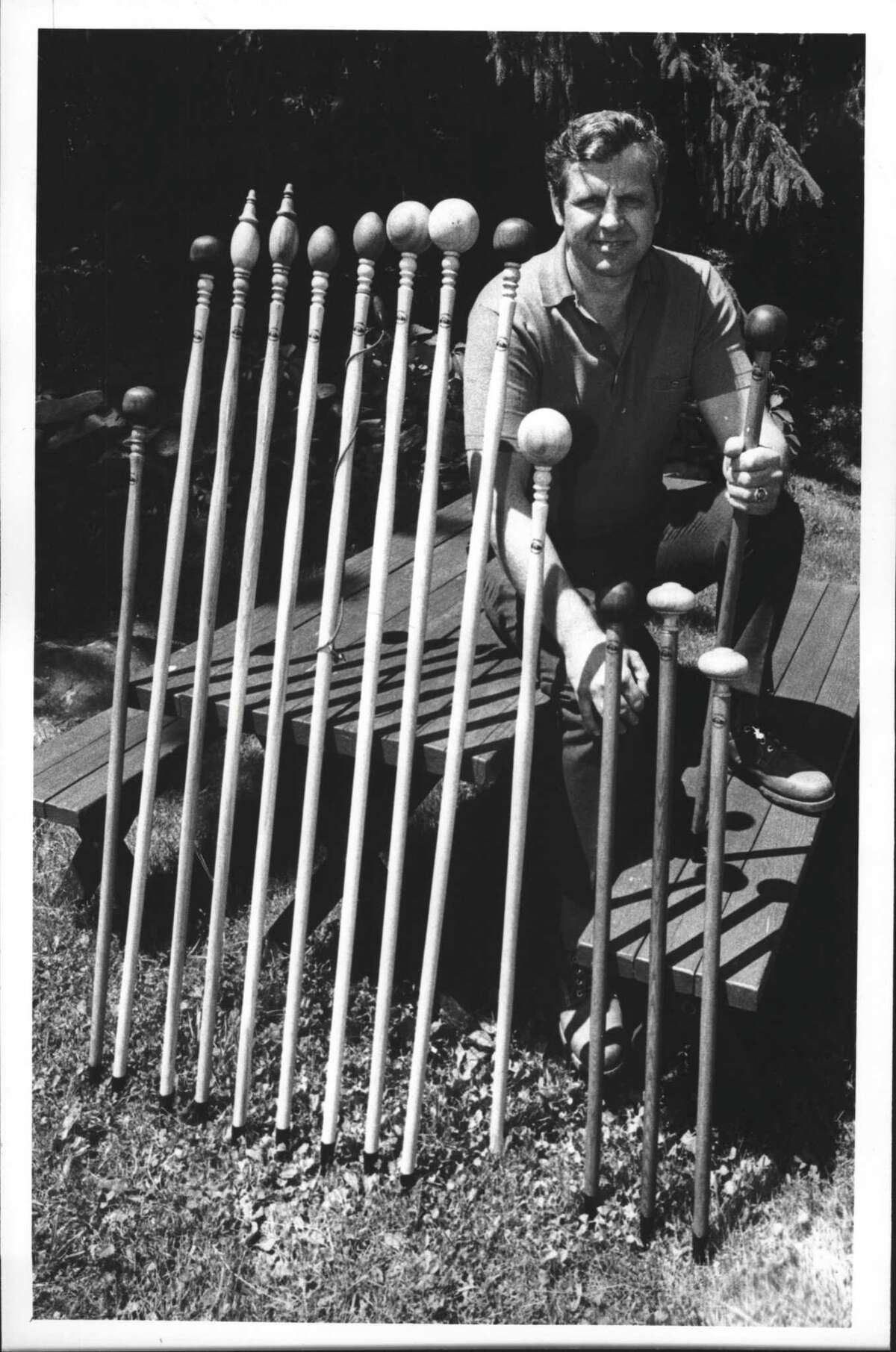 Grafton, New York - Al Fromberger, owner of Pestenkill Hiking Staff Manufacturing Co., poses in his Grafton backyard with an assortment of his sticks. June 26, 1990 (Paul D. Kniskern, Sr./Times Union Archive)