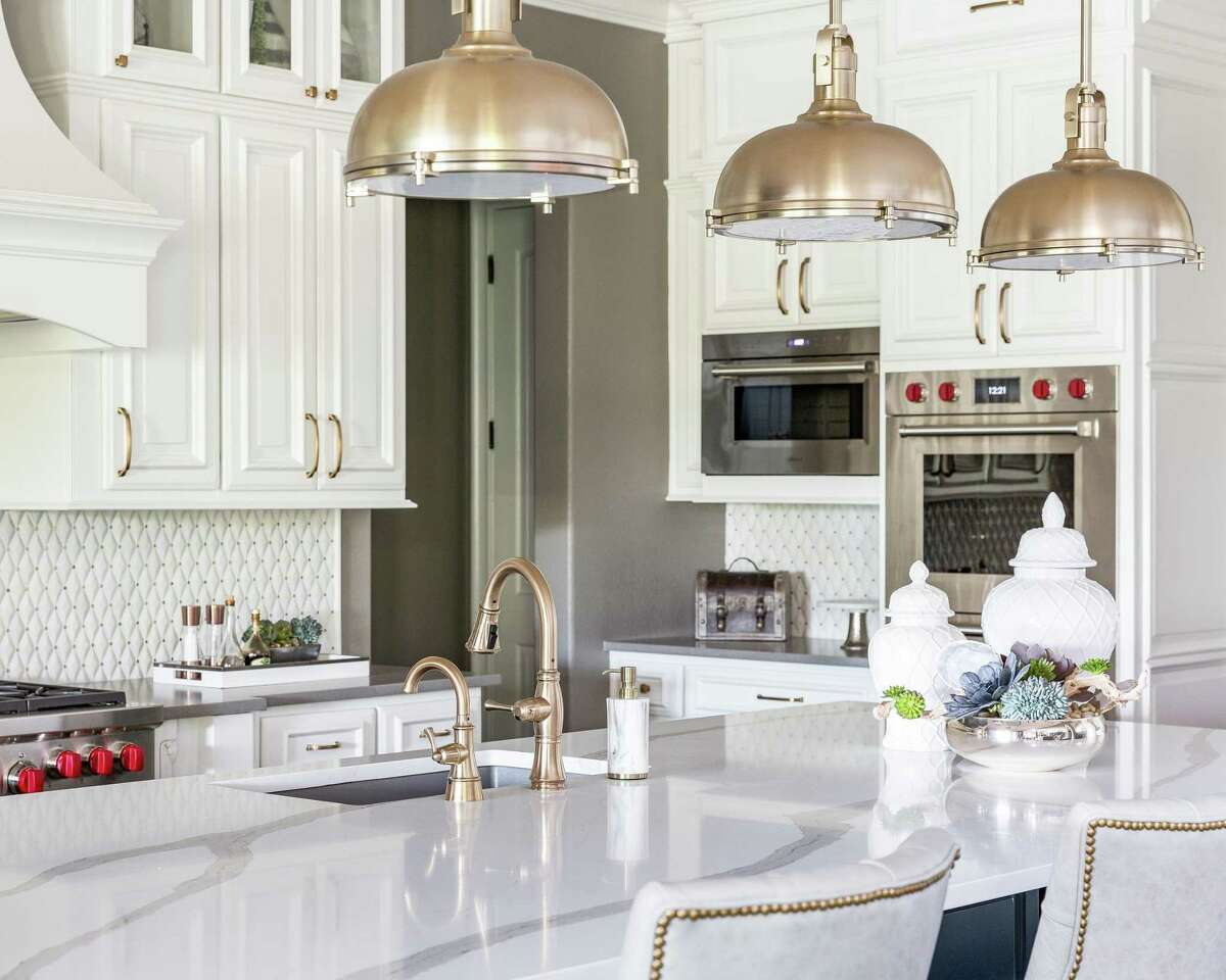 Amanda Malone prefers gold over silver, so interior designer Nikole Starr brought in gold pendants, plumbing fixtures and cabinet hardware to the kitchen.