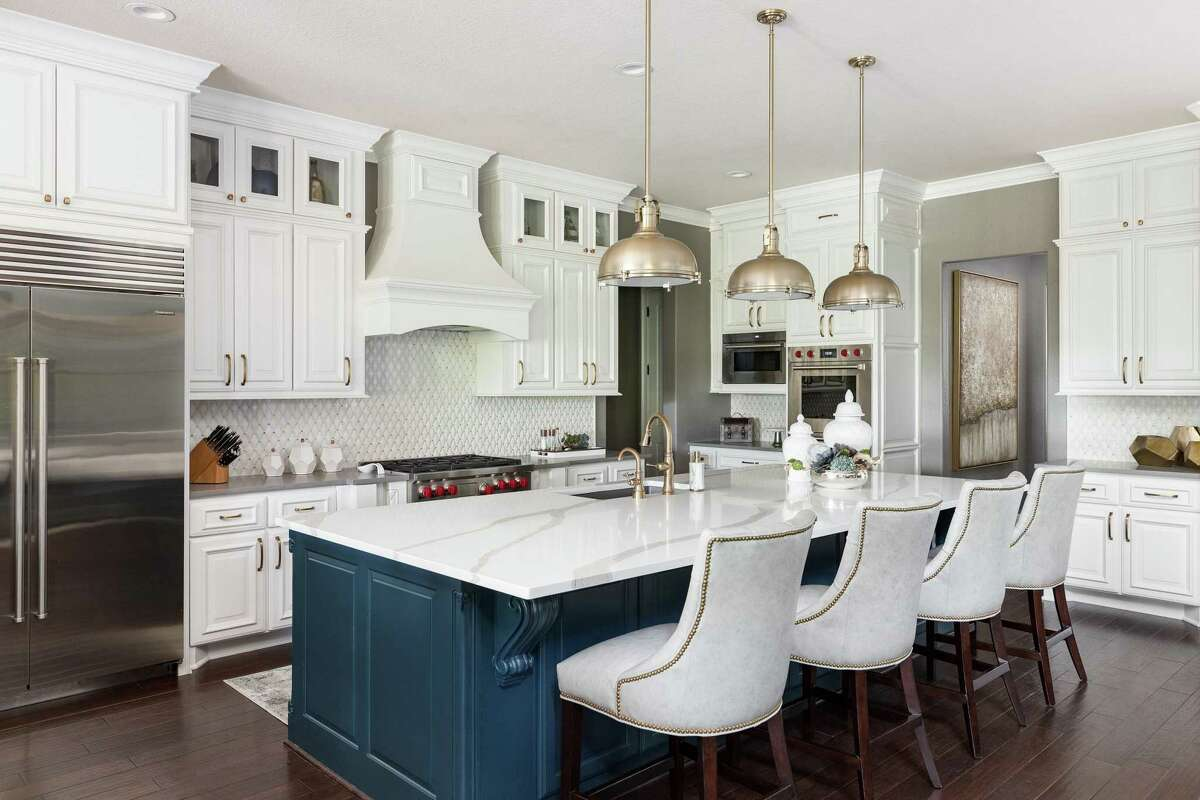 Starr added a top row of cabinets to the existing cabinets in the Malones' kitchen.