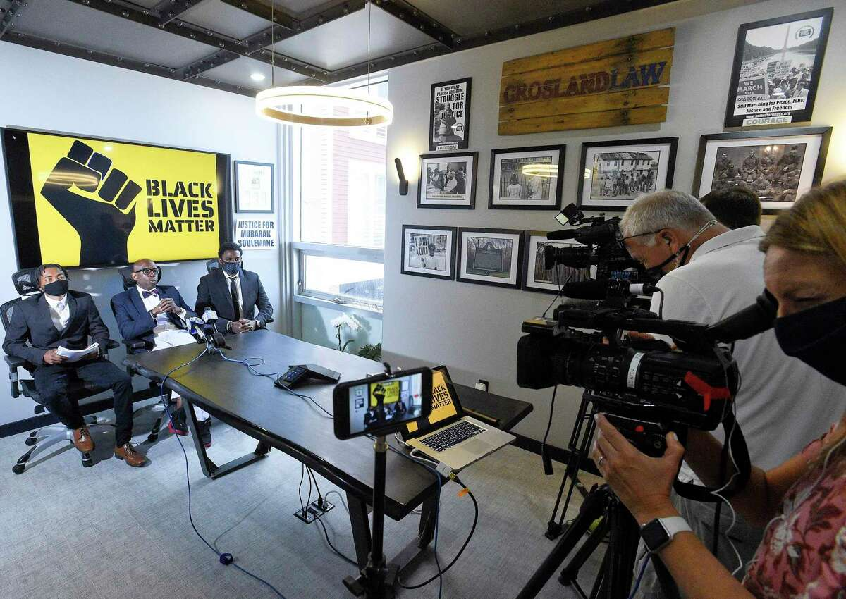Tarae Frazier of Stamford left, and his cousin Tyshawn Frazier of Norwalk, speak with the media at their attorney's, Darnell Crosland, center, office on June 25, 2020 in Stamford, Connecticut. The Frazier's, along with other individuals were allegedly accosted by Steven Dudek at the Cove Island Marina loading ramp on Saturday. The incident was captured on video and is being investigated by the Stamford Police.