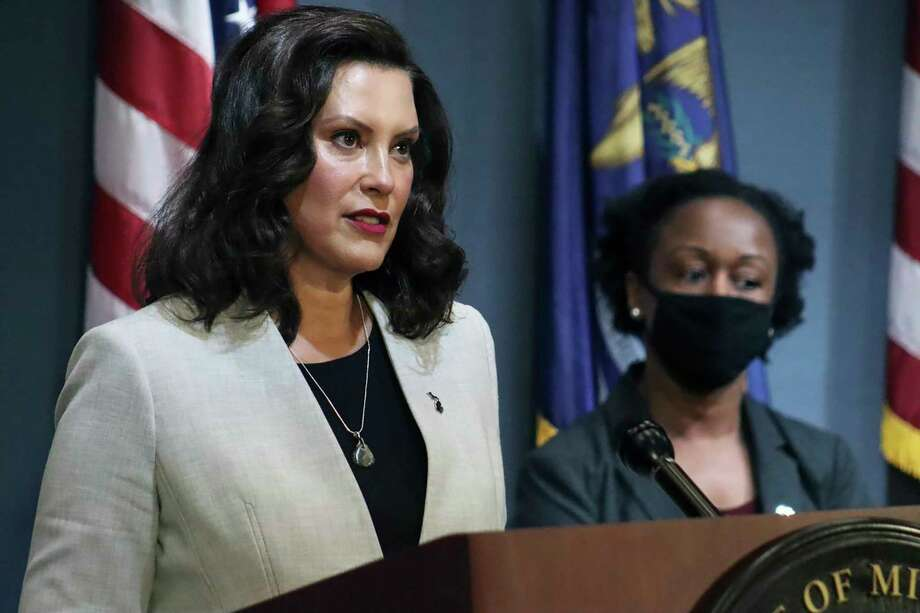FILE - In this June 17, 2020, pool file photo provided by the Michigan Office of the Governor, Michigan Gov. Gretchen Whitmer speaks in Lansing, Mich. WhitmerThursday signed Executive Order 2020-133, which sets guidelines for the safe return of professional sports, without a live audience.(Michigan Office of the Governor via AP, Pool, File) / Michigan Governors Office