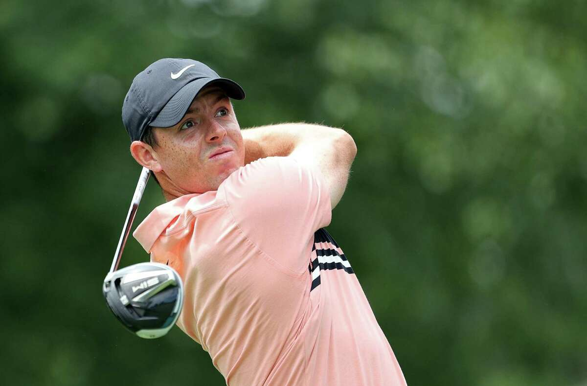 Rory McIlroy watches his drive on the seventh tee during the first round of the Travelers Championship at TPC River Highlands on Thursday in Cromwell.
