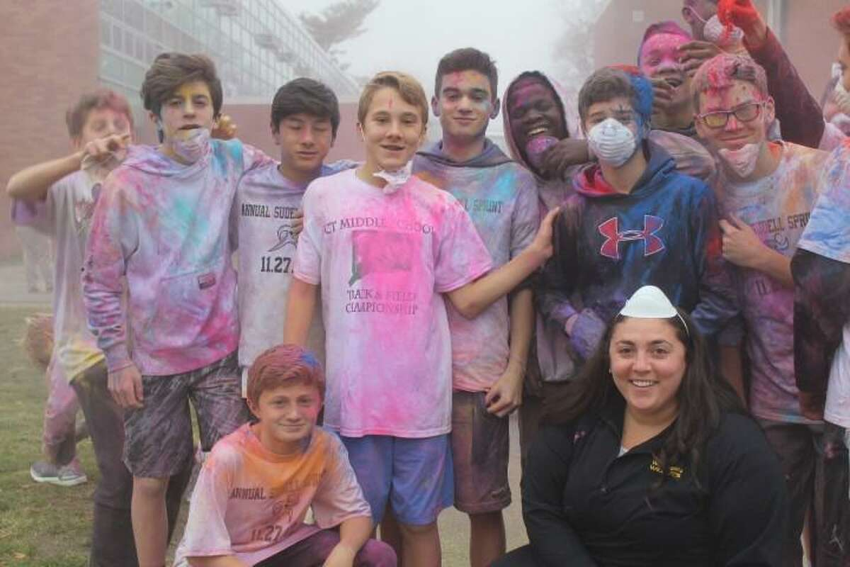 Western Middle School counselor Erin Montague and her students at a color run.
