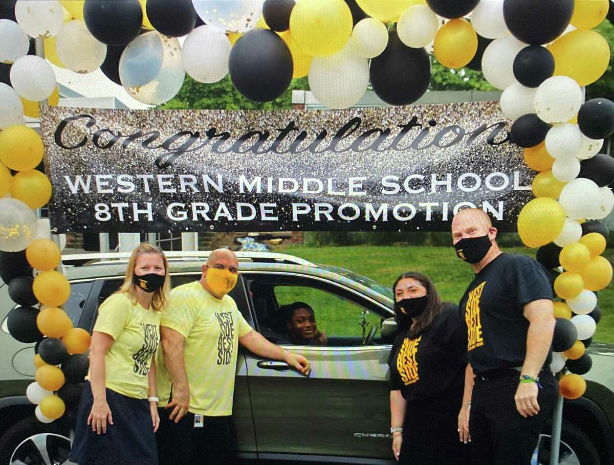 Western Middle School counselor Erin Montague at the drive-through promotion ceremony this year for eighth-graders.