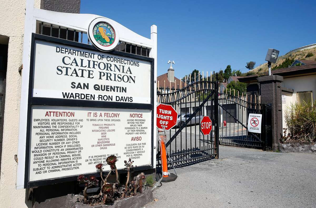 The main gate to San Quentin State Prison is seen on Thursday, June 25, 2020. Confirmed COVID-19 cases inside the prison walls have skyrocketed prompting calls for the early release of prisoners serving time for low risk crimes nearing the end of their sentence.