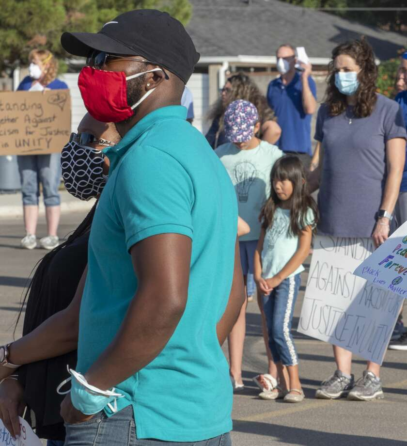 City leaders are urging Midlanders to continue to wear a mask when out in public, like many did at the prayer vigil June 16 with Christians For A Change. Tim Fischer/Reporter-Telegram Photo: Tim Fischer/Midland Reporter-Telegram