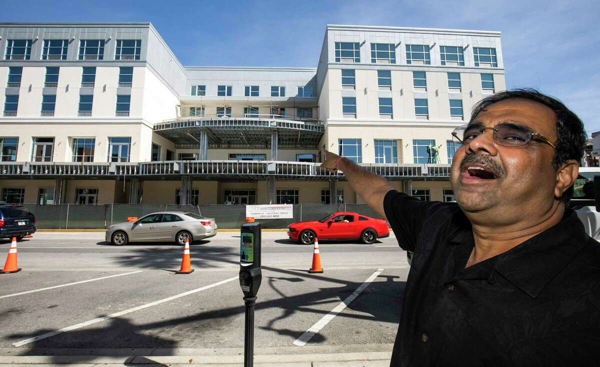 FILE - In this Oct. 23, 2019 file photo, developer Danny Gaekwad talks about the roof top bar on his Hilton Garden Inn hotel that is presently under construction in Ocala, Fla. Since the coronavirus crisis started, hotel owners say they are struggling to get relief on a type of loan that Wall Street investors buy. [Doug Engle/Ocala Star-Banner via AP)