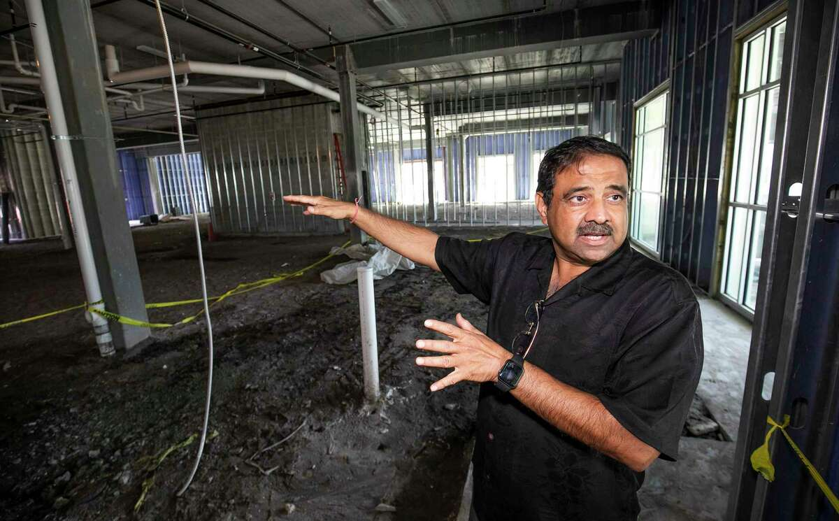 FILE - In this Oct. 23, 2019 file photo, Developer Danny Gaekwad talks about the Food Hall on the first flood while giving a tour the Hilton Garden Inn hotel that is presently under construction in Ocala, Fla. Since the coronavirus crisis started, hotel owners say they are struggling to get relief on a type of loan that Wall Street investors buy. [Doug Engle/Ocala Star-Banner via AP)