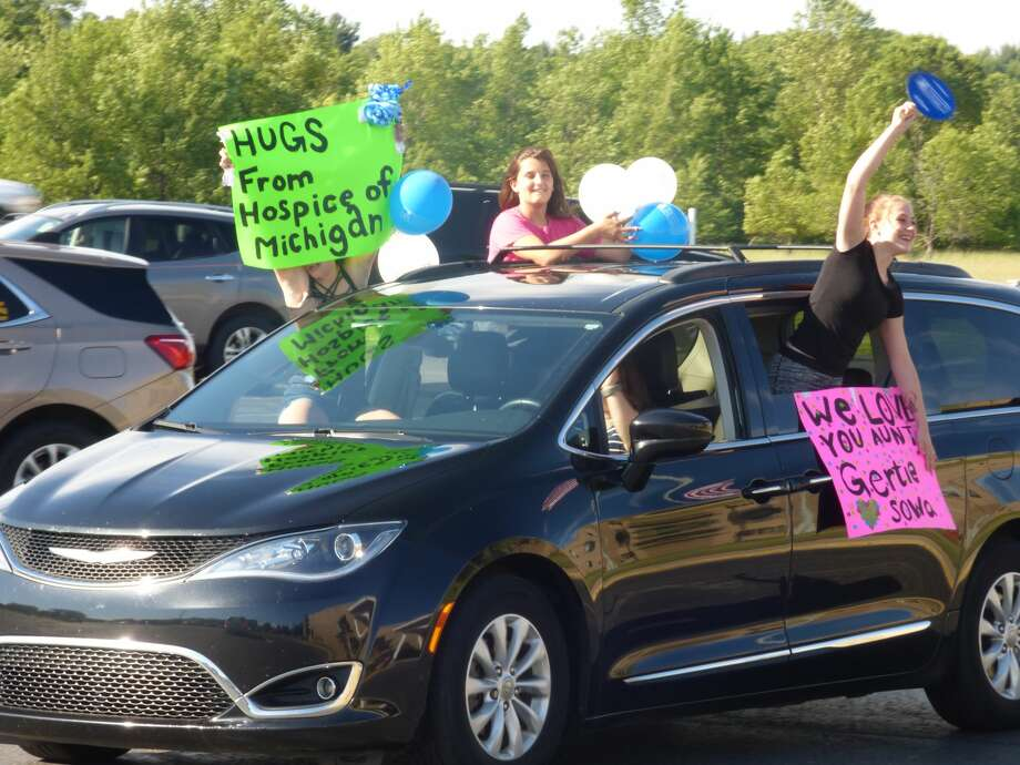 """A """"Honk for Hugs"""" car parade was held June 25 to help lift the spirits of residents who have been socially isolated since the facility closed to visitors in March. Local first responders joined with family and other community-members who decorated their cars, waved signs and honked horns for residents of the Manistee County Medical Care Facility. Photo: Scott Fraley"""