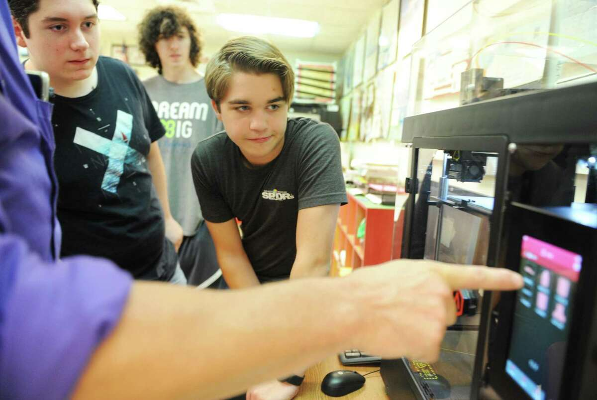 Sophomore Daniel Thiverge, left, and Preston Bitteker work with the 3D printer during an Innovation Lab class at Greenwich High School in Greenwich, Conn. Thursday, Sept. 28, 2017. Will students be back in the classroom this fall?