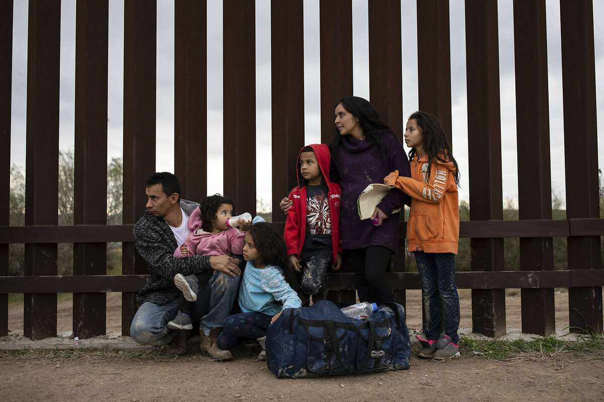 FILE -- A Honduran family seeking asylum in the United States waits to be taken into custody by Border Patrol officers in Penitas, Texas, Feb. 1, 2019. In a victory for the Trump administration, the Supreme Court ruled on June 25 that immigrants whose requests for asylum were rejected in bare-bone summary proceedings may not contest the denials in federal court. (Tamir Kalifa/The New York Times)