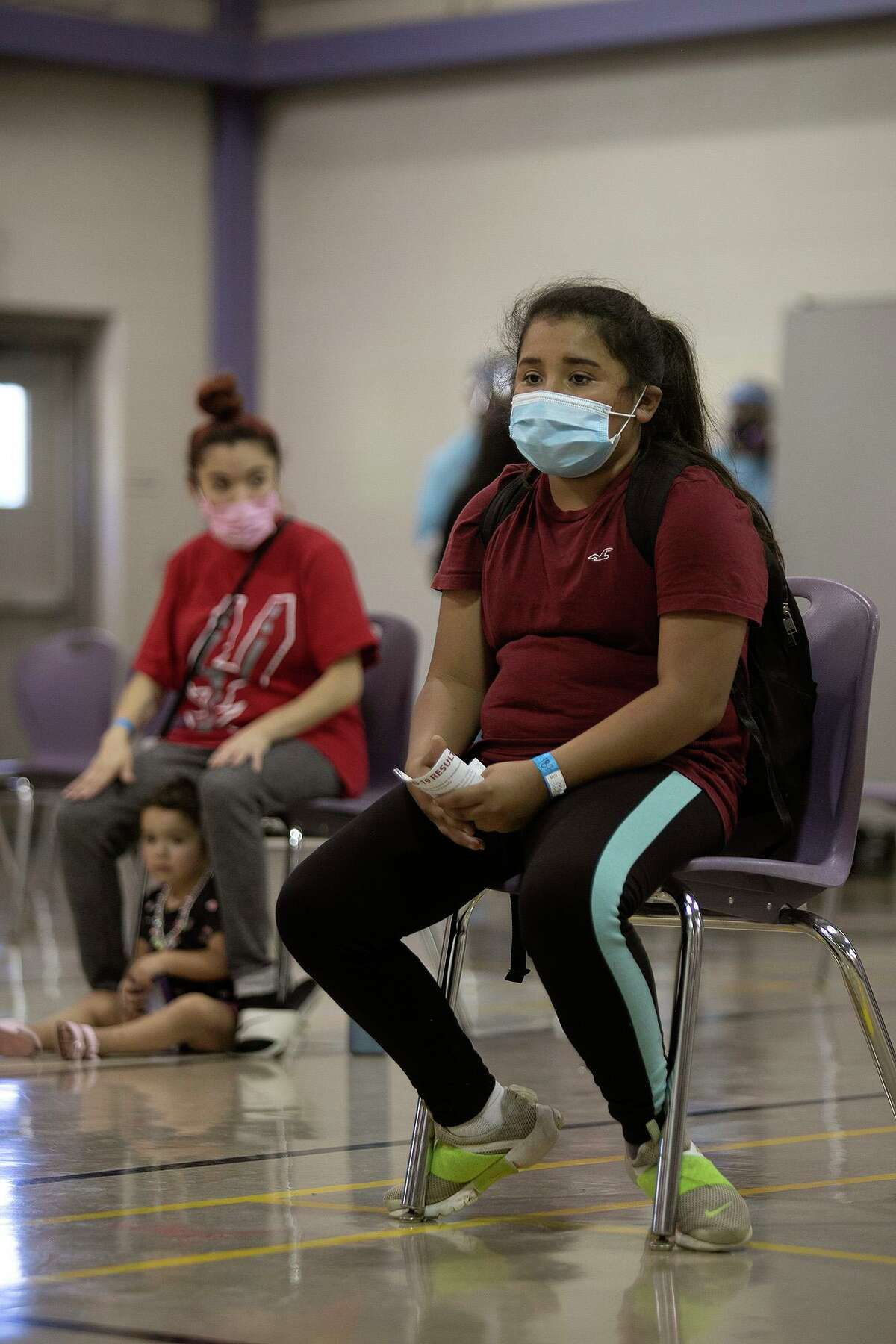 Yocelyn Moreno, 12, waits her turn for a COVID-19 test at Will Rodgers Academy, one of San Antonio Metropolitan Health's walk-up testing sites.