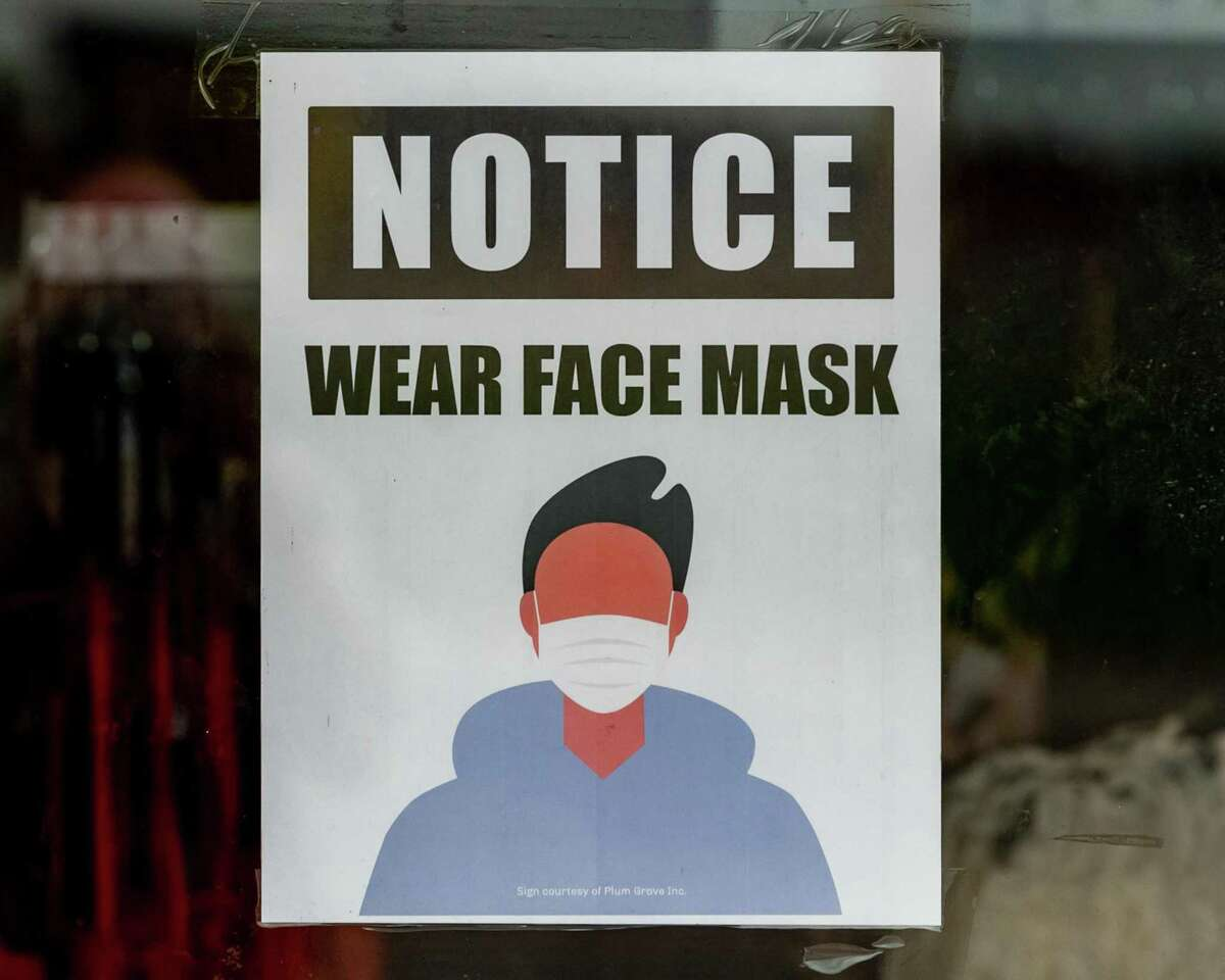 About a half dozen signs are posted near the entrance to the Rainbow apparel shop in the North Park Plaza to let shoppers know that masks are required for shopping in the store. Photo made on June 24, 2020. Fran Ruchalski/The Enterprise