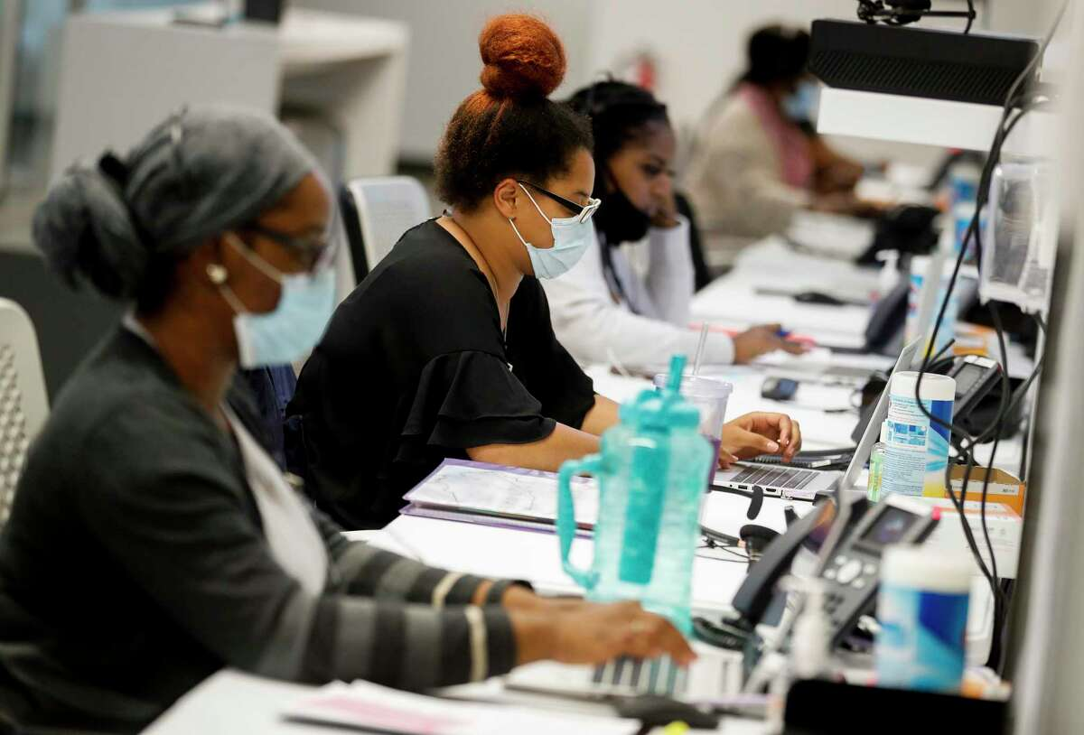 Harris County Health Department contact tracers Dami Kamara, left to right, Madeline Brown, and Kandice Childress work on their assigned cases Thursday, June 25, 2020, in Houston.