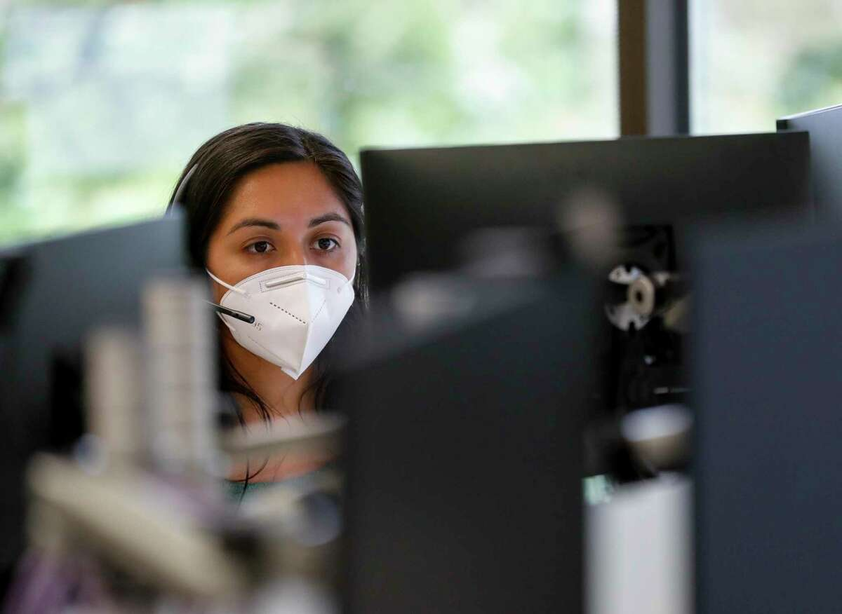 Alejandra Camarillo works on cases at Harris County Health Department. The agency launched online tracing last week.