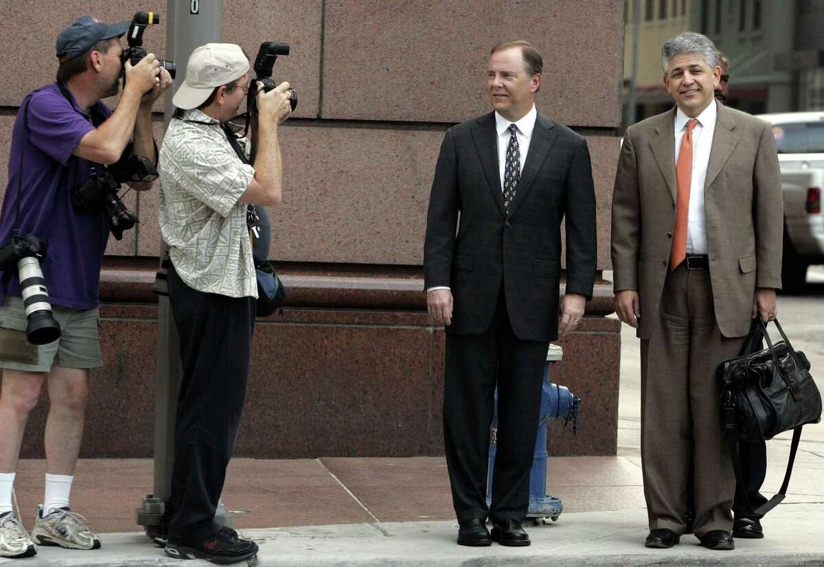 Former Enron executive Jeffrey Skilling, center, and his attorney Daniel Petrocelli, right, head to court in 2006 in Houston. Recently out of prison, Skilling is pitching a new venture incorporated by his wife.