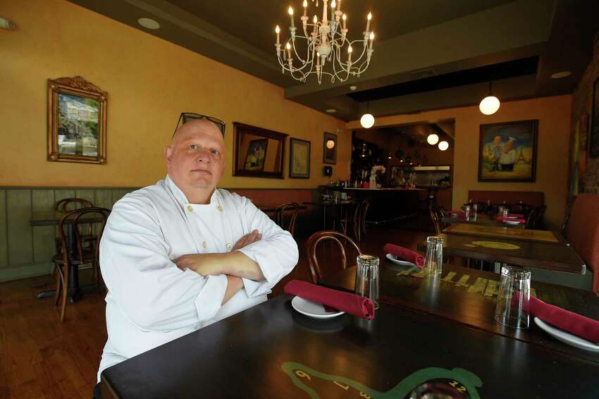 Erik Erlichson, co-owner of Chez Vous Bistro on Bedford Street is photographed on June 27, 2020 at his restaurant in Stamford, Connecticut.