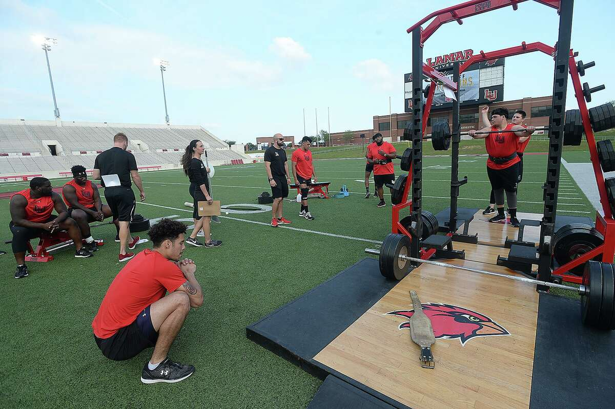 Lamar's competitors practice before the start of the football team's annual Night of Champions weightlifting event on the football field Tuesday night. Photo taken Tuesday, April 30, 2019 Kim Brent/The Enterprise