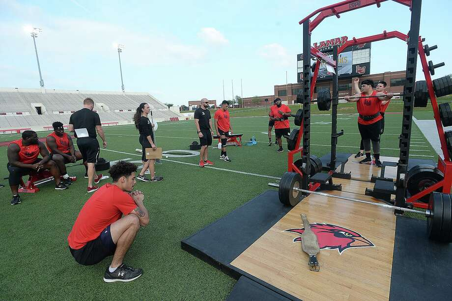 Lamar's competitors practice before the start of the football team's annual Night of Champions weightlifting event on the football field Tuesday night.   Photo taken Tuesday, April 30, 2019 Kim Brent/The Enterprise Photo: Kim Brent / The Enterprise / BEN
