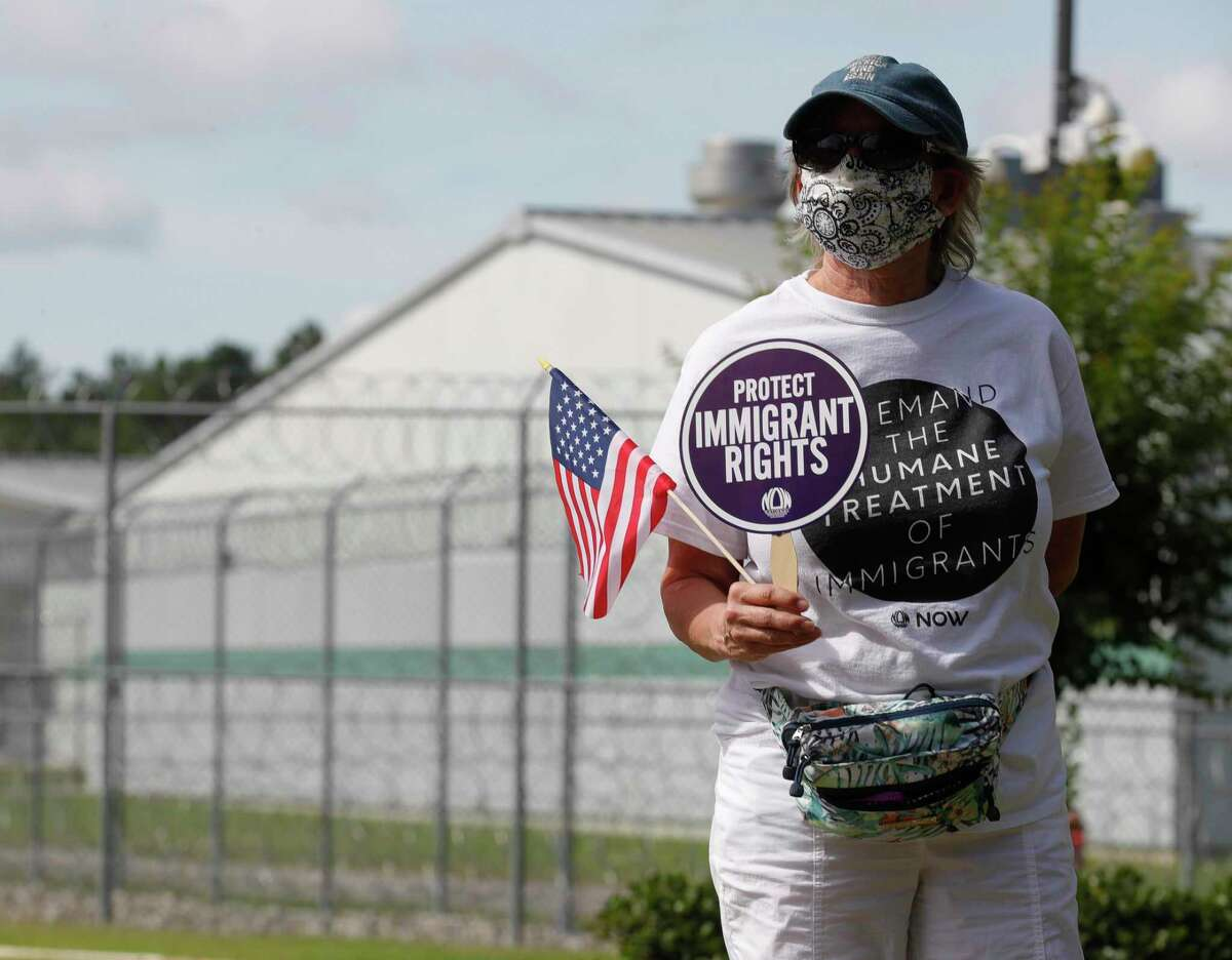 Immigrant rights activist Gina Biekman takes part in a vigil in front of the Joe Corley Detention Facility, Friday, May 29, 2020, in Conroe. Physicians with Doctors for America and immigrant rights activists began the 24-hour vigil to demand the release of detained asylum seekers, refugees, and nonviolent immigrants to prevent the spread of COVID-19. Texas is the state with most confirmed COVID-19 cases of immigrants confined in Immigration and Custom Enforcements' detention centers, official counts indicate.