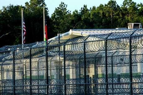 A fence at a detention facility in Conroe is pictured.