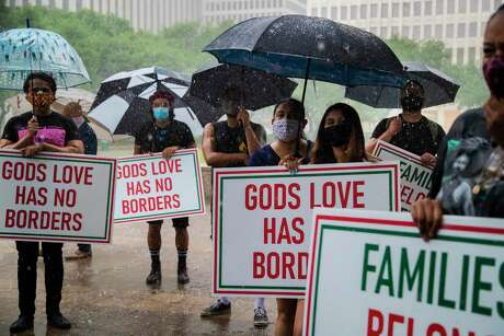 Members of the Council on American-Islamic Relations (CAIR-Houston) and FIEL Houston join in a peaceful protest under the rain in front of the Houston City Hall for immigrants in ICE detention on Saturday, June 20, 2020, in Houston.