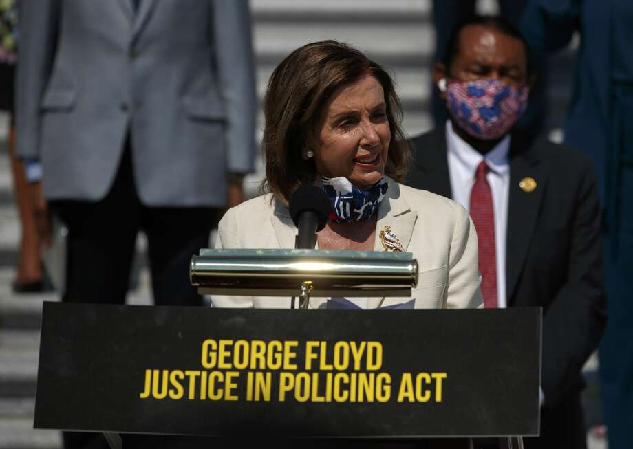 House Speaker Nancy Pelosi of Calif., joined by House Democrats spaced for social distancing, speaks during a news conference on the House East Front Steps on Capitol Hill in Washington, Thursday, June 25, 2020, ahead of the House vote on the George Floyd Justice in Policing Act of 2020. (AP Photo/Carolyn Kaster) Photo: Carolyn Kaster/AP / Copyright 2020 The Associated Press. All rights reserved