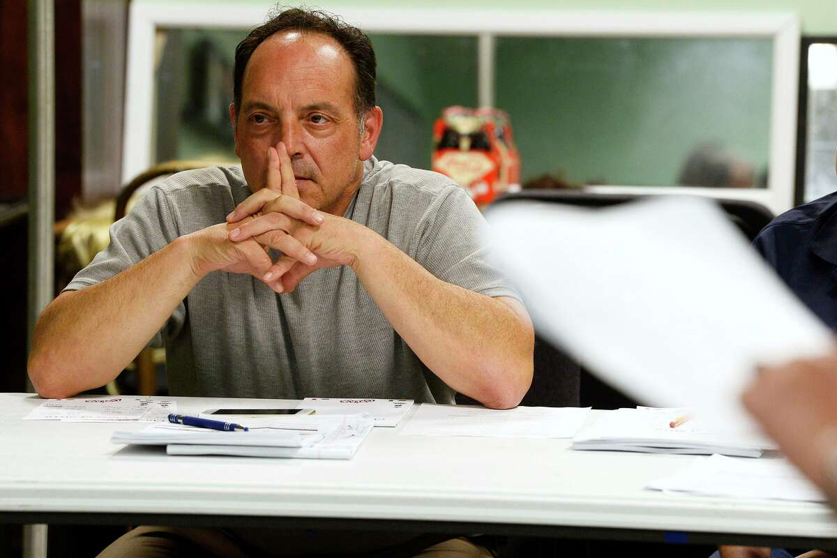 Director John Manfredi watches during auditions for the reading of
