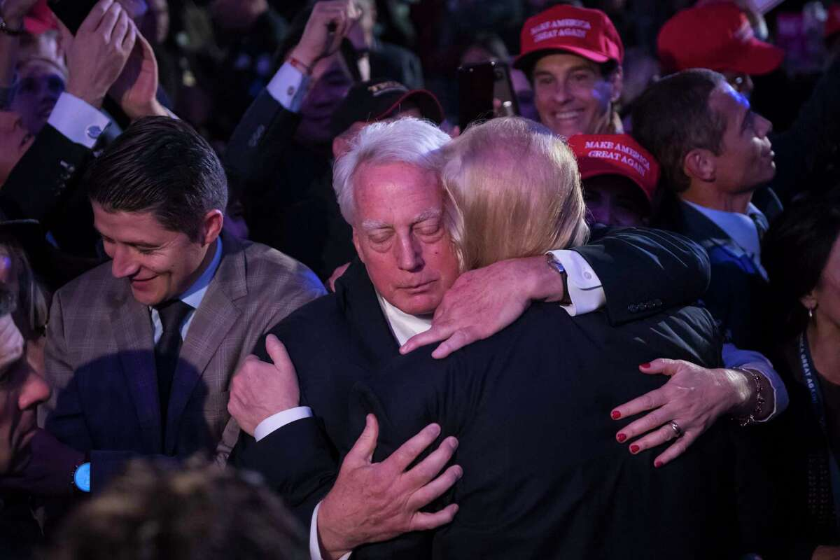President-elect Donald Trump hugs his brother Robert Trump in the crowd after speaking during an election rally in Midtown Manhattan on Nov. 9, 2016.