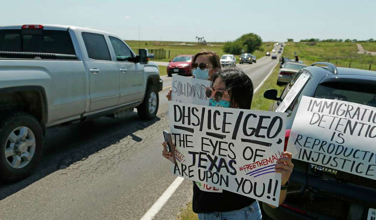 Laura Molinar pulls off to the side as other advocacy group car protest by driving past at Karnes County Residential Center 409 FM1144, Karnes City, Texas, 78118. Advocacy groups are protesting family detention amid the pandemic, as coronavirus spreads rapidly through detention facilities across the country on Saturday, May 16, 2020.