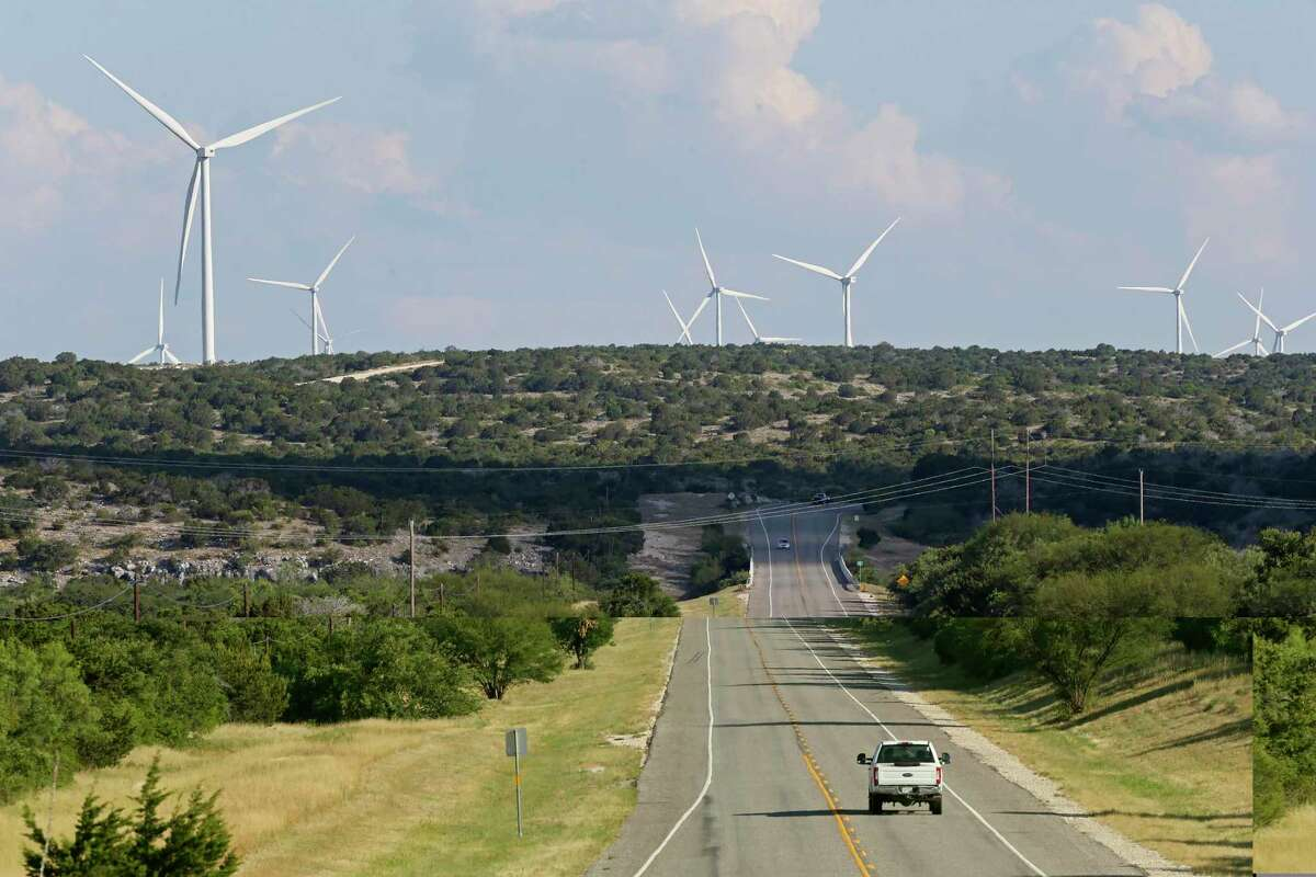Another view of the undeveloped landscape and wind turbines.