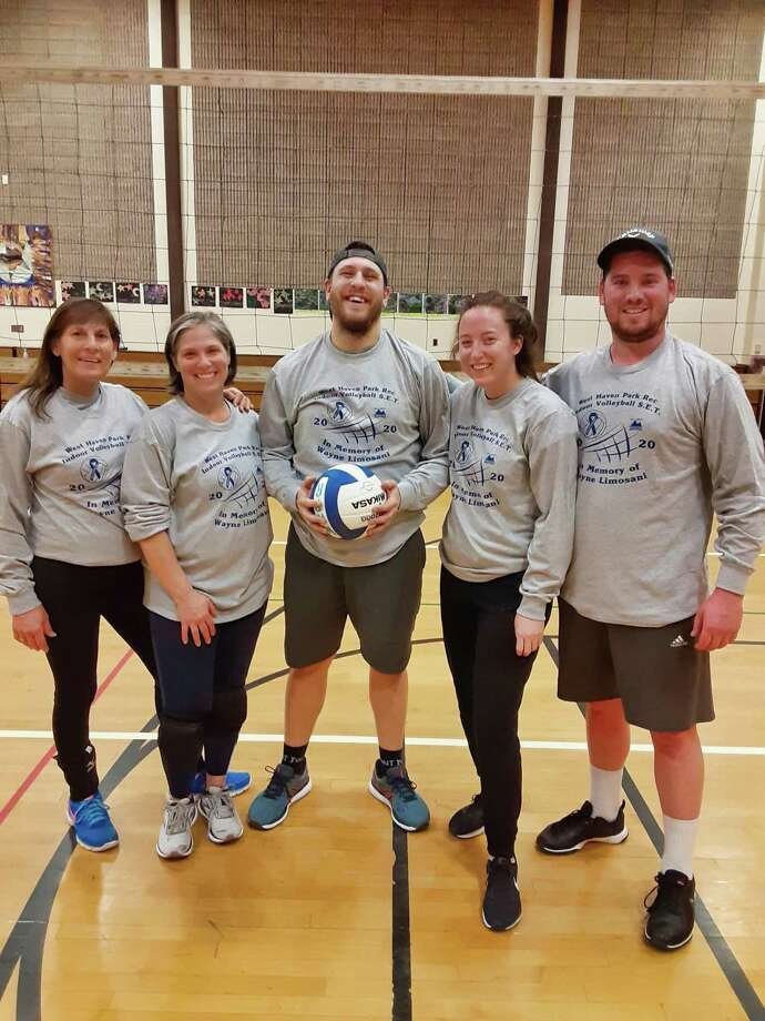 Team Crab People are all smiles after winning the Department of Parks and Recreation's coed volleyball tournament in memory of former longtime participant Wayne Limosani on Thursday night, March 5. The single-elimination tournament raised $975 from the sale of T-shirts for an athletic scholarship established in Limosani's name. The scholarship awards funds to a senior on the West Haven High School girls volleyball team who plans to continue her education. Photo: Contributed Photo