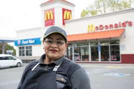 In this file photo, Ana Martinez, who does not get health insurance through her employer, poses for a portrait during a work break at McDonald's Friday, March 20, 2020, in Milpitas, Calif. The pandemic has made the limits of employer-sponsored health care even more glaring, argues author Soleil Shah.