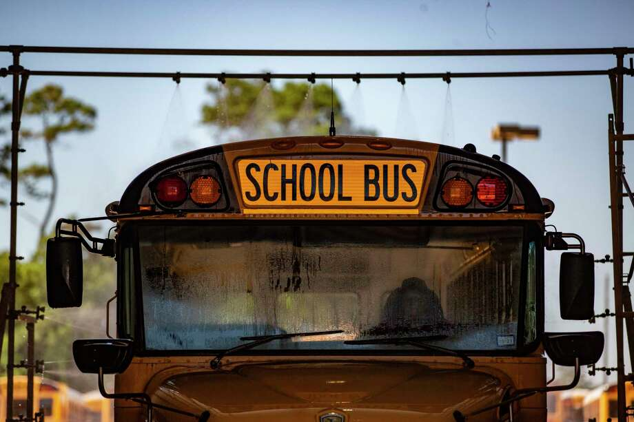 An Humble ISD school bus gets a wash on Thursday, June 11, 2020, in Humble in preparation for the new school year. Photo: Marie D. De Jesús, Houston Chronicle / Staff Photographer / © 2020 Houston Chronicle