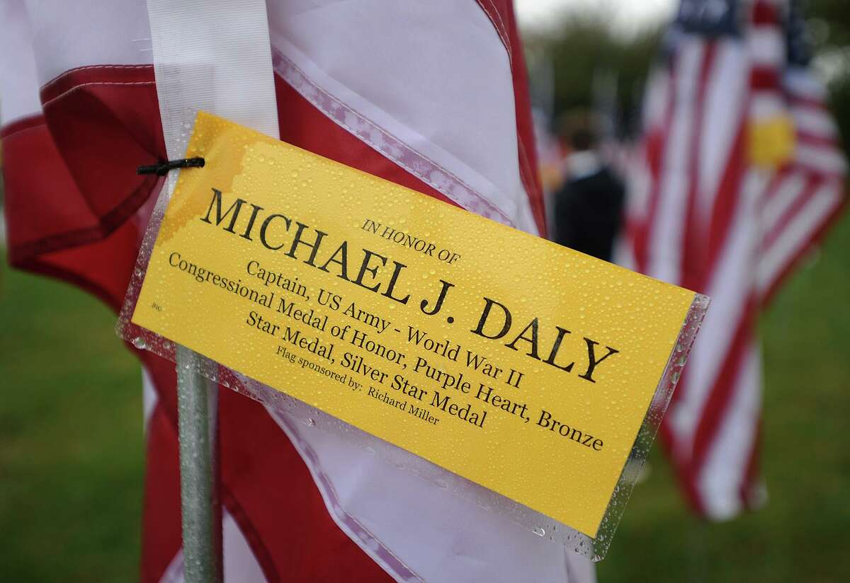 Individual flags are dedicated in the names of veterans, including World War II Medal of Honor winner Michael J. Daly, at Field of Valor, a display of 110 American flags at Jennings Park on the Post Road in Fairfield in 2017.