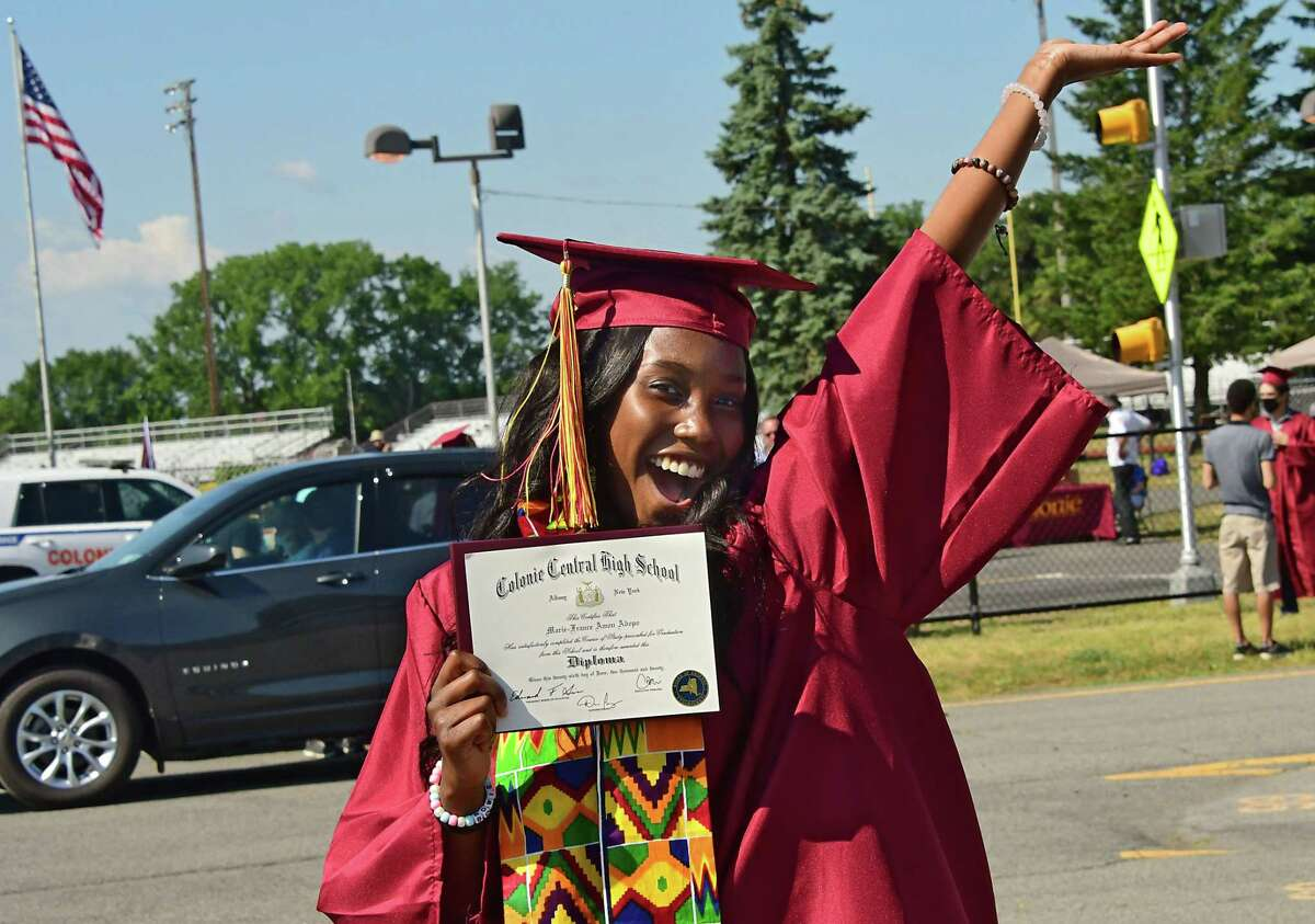 Graduate Marie-France Adopo was glad to have received her diploma as Colonie Central High School holds graduation for seniors on their football field on Friday, June 26, 2020 in Colonie, N.Y. (Lori Van Buren/Times Union)