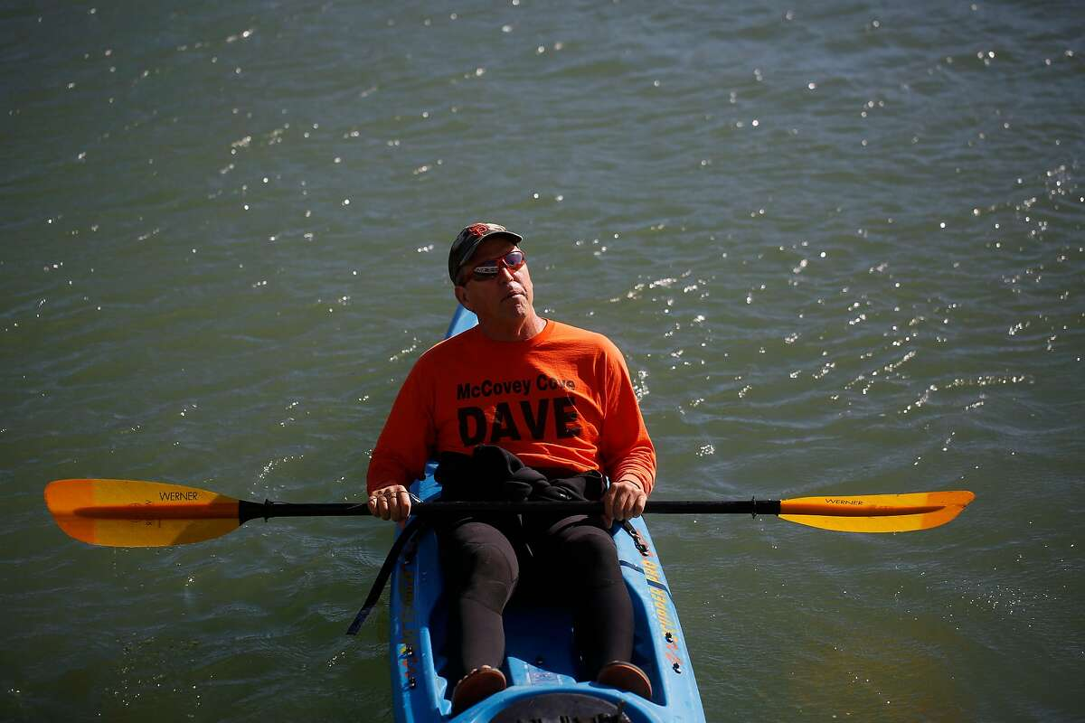 """Giants fan Dave """"McCovey Cove Dave"""" Edlund waits in his kayac before the start of game five of the World Series against the Kansas City Royals at AT&T Park on Sunday Oct. 26, 2014 in San Francisco, Calf."""