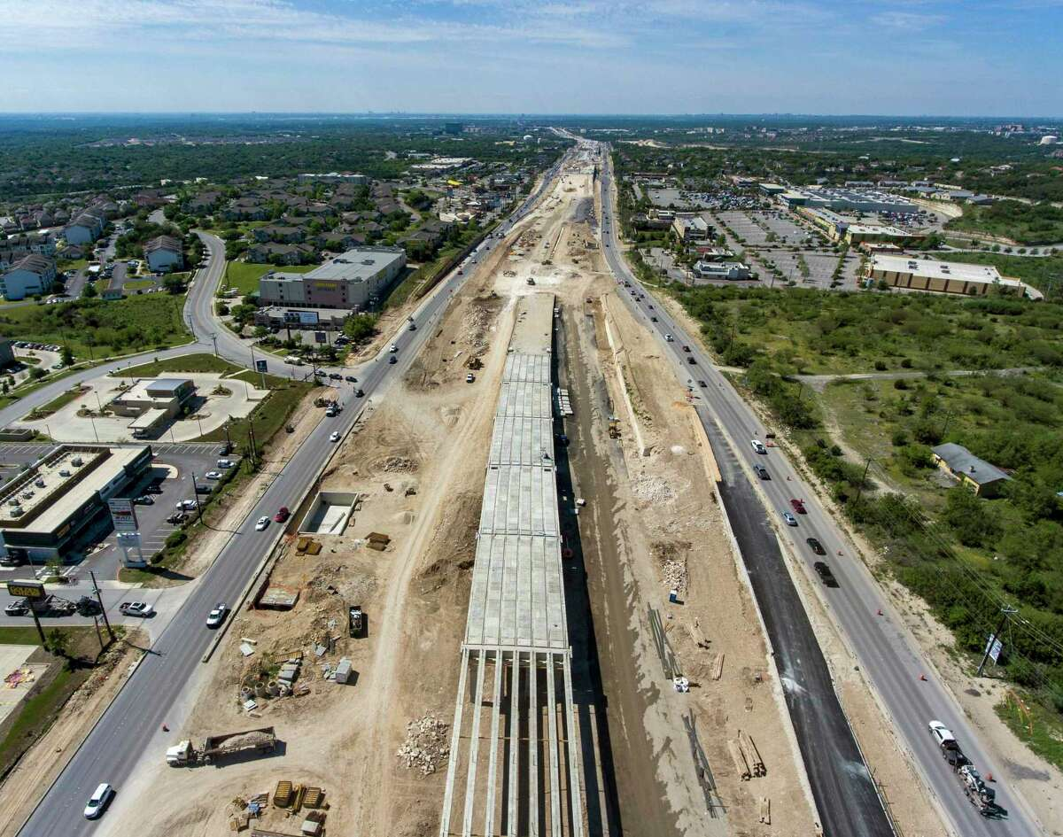 Vehicles drive April 1, 2020, on the outside lanes U.S. 281 north of Loop 1604 while construction work continues. The new lanes run northbound from Loop 1604 to south of Evans Road.