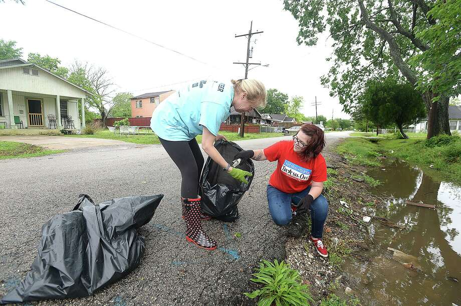 Melanie Heartfield and Elayna McLaughlin clear debris from a ditch and empty lot near Marie Street as they join in the clean-up efforts throughout Pear Orchard during the 2018 Beaumont Trash-Off, which was held in conjunction with a statewide event. Over 800 volunteers signed up for the event, heading to areas throughout the city which inspectors identified as being the worst in terms of litter and trash.  Photo taken Saturday, April 7, 2018 Kim Brent/The Enterprise Photo: Kim Brent / Beaumont Enterprise / BEN