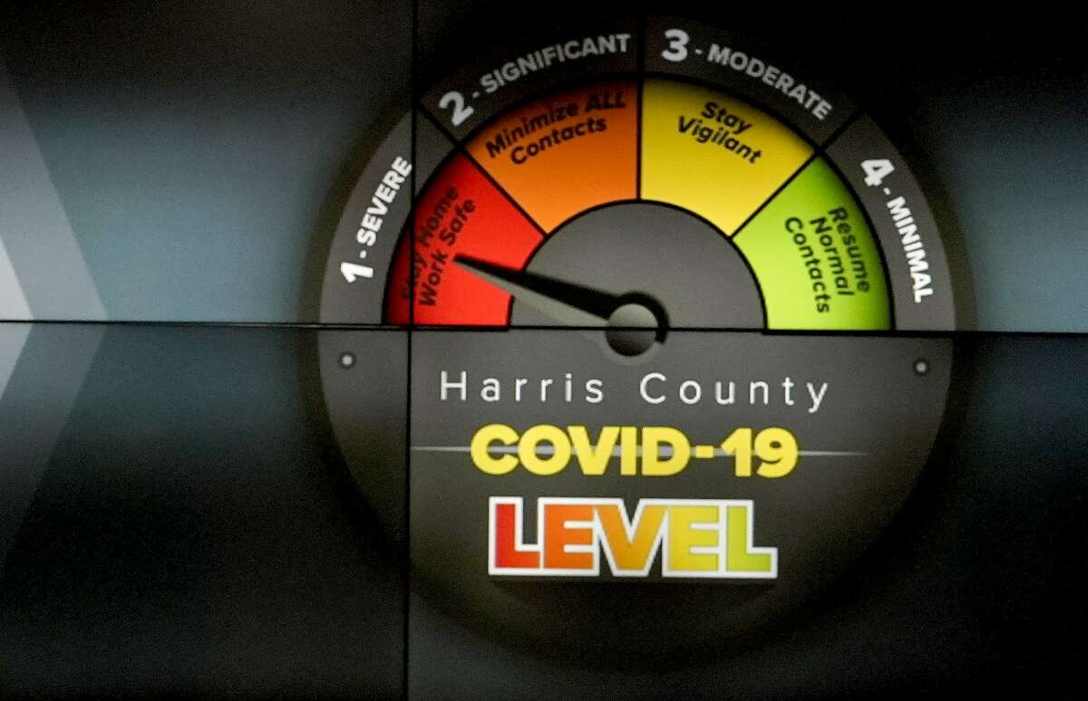 A screen display shows the theat level while Harris County Judge Lina Hidalgo speaks at a press conference to announce the COVID-19 threat level is at the worst level of red, which is severe, shown at Houston TranStar, 6922 Katy Rd., Friday, June 26, 2020, in Houston.