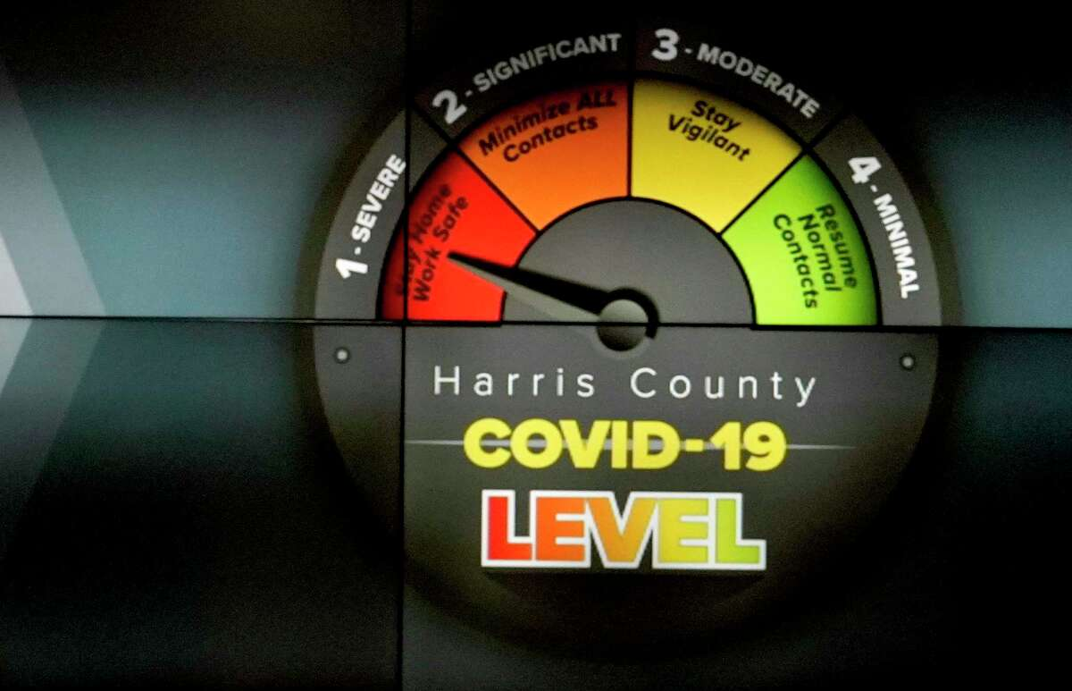 A screen display shows the threat level while Harris County Judge Lina Hidalgo speaks at a press conference to announce the COVID-19 threat level is at the worst level of red, which is severe, shown at Houston TranStar, 6922 Katy Rd., Friday, June 26, 2020, in Houston.