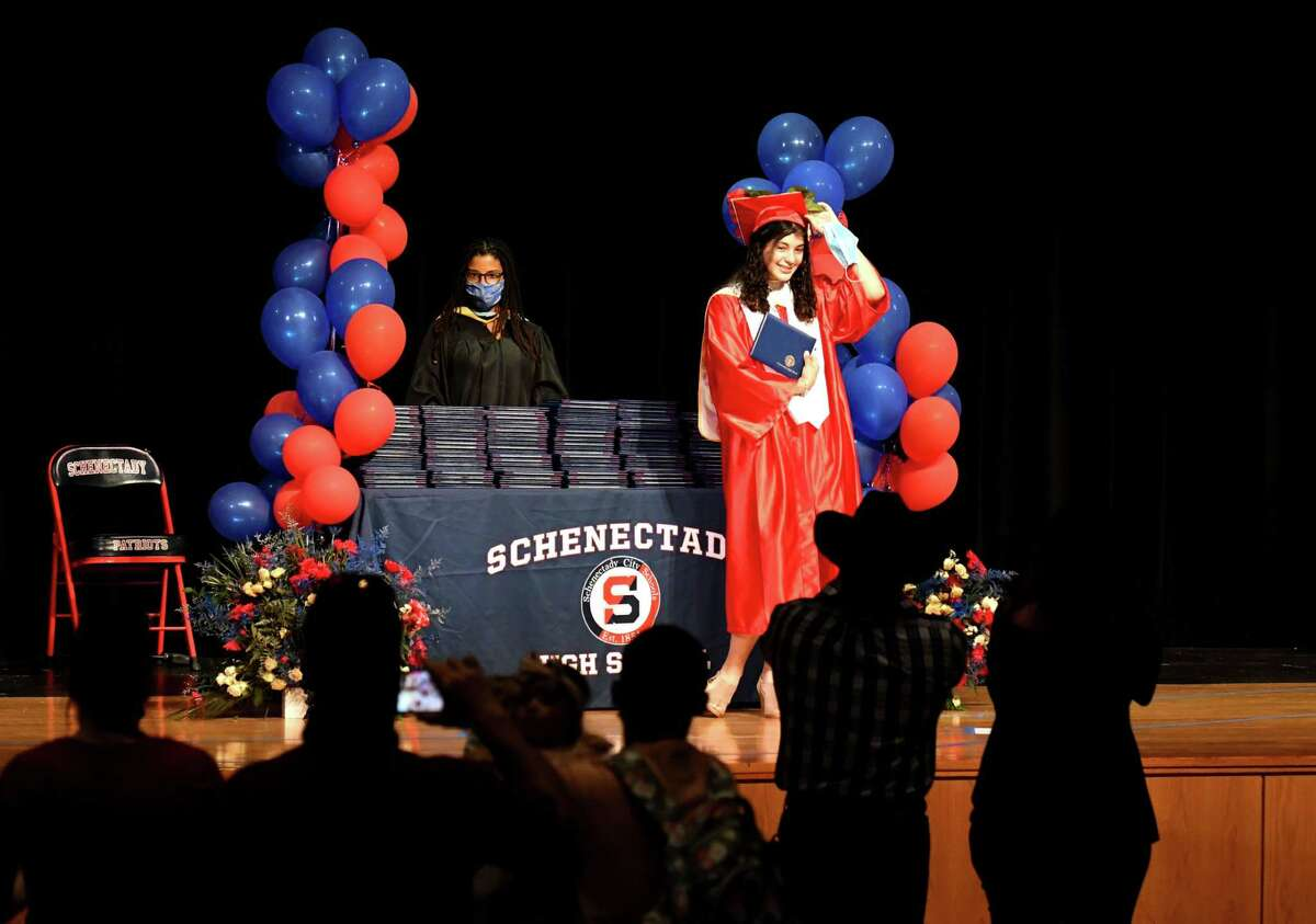 Graduating Schenectady High School senior Deceane Martinez-Keeney stands for a photo during a commencement ceremony on Friday, June 26, 2020, in Schenectady, N.Y. Keeping with coronavirus safety measures, students and family entered the school auditorium in individual groups to receive diplomas. (Will Waldron/Times Union)