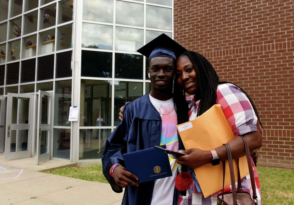 Graduating Schenectady High School senior Malakai Myles is pictured with his mother, Fatimah Christmas, following commencement on Friday, June 26, 2020, in Schenectady, N.Y. (Will Waldron/Times Union)