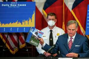 Gov. Greg Abbott addresses the surge in COVID-19 across Texas during a news conference this week. The surge in cases reflects a horrifying lack of leadership at the national level.