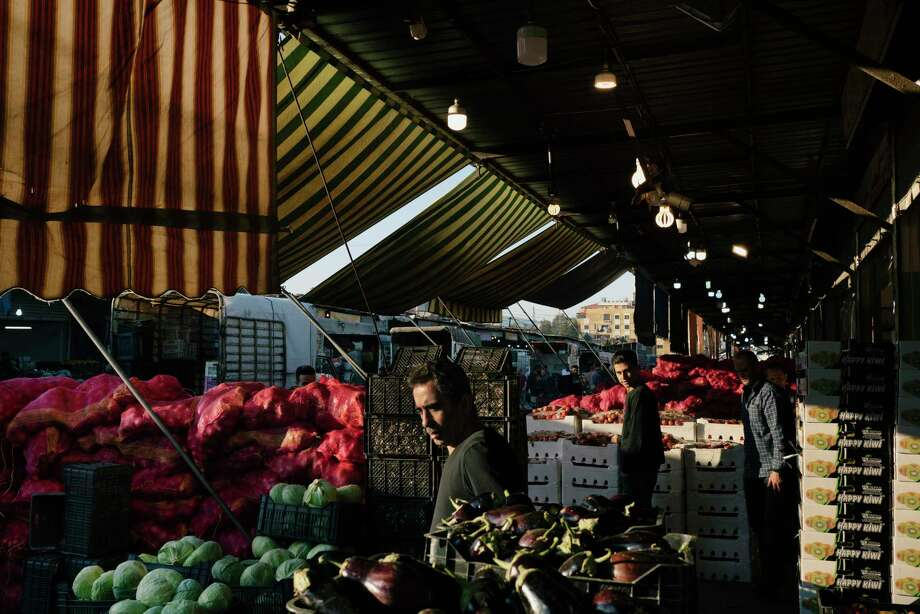 Traders at work in the main fruit and vegetable market in Beirut. The price of food has soared in recent weeks. Photo: Photo For The Washington Post By Lorenzo Tugnoli / Lorenzo Tugnoli
