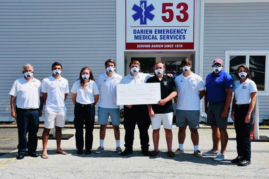 Darien High School football players sold masks and donated a portion of the proceeds to Darien EMS Post 53. Photo: Darien Blue Wave Football
